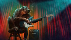 ギターを弾いている猿